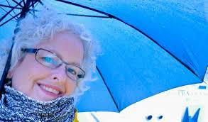 Smiling 50s lady with umbrella